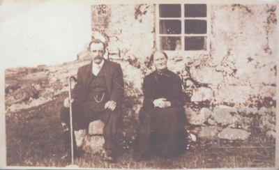 Old woman and her son sitting outside old cottage; ULMPH 2000 0398