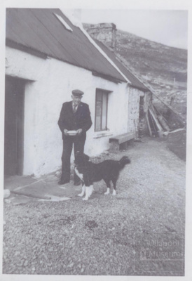 Man with collie dog outside house; ULMPH 2000 0575