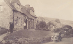 Gardener's house with three people and old car; ULMPH 2000 0184