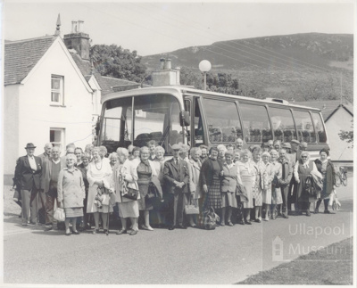 Cheery group of old folks outside bus at village hall; 1960?; ULMPH 2000 0566