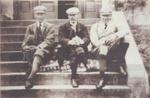3 gentlemen sitting on steps; 1900?; ULMPH 2000 0177
