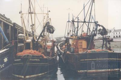 Fish boats at pier; ULMPH 2000 0012