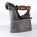 Charcoal Iron with wooden handle; T&C Clark; 1900s; RX.1975.64.8