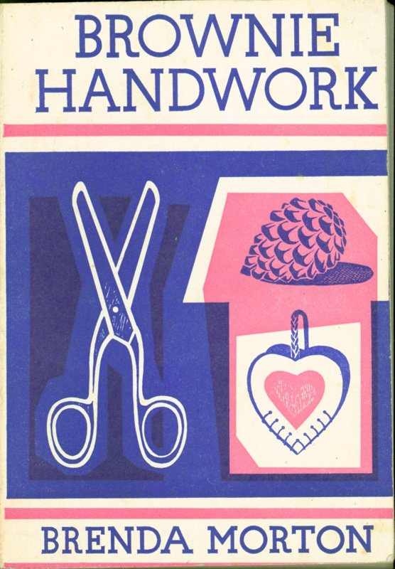 "Front cover of ""Brownie Handwork"" book, featuring a pair of scissors and craft materials"