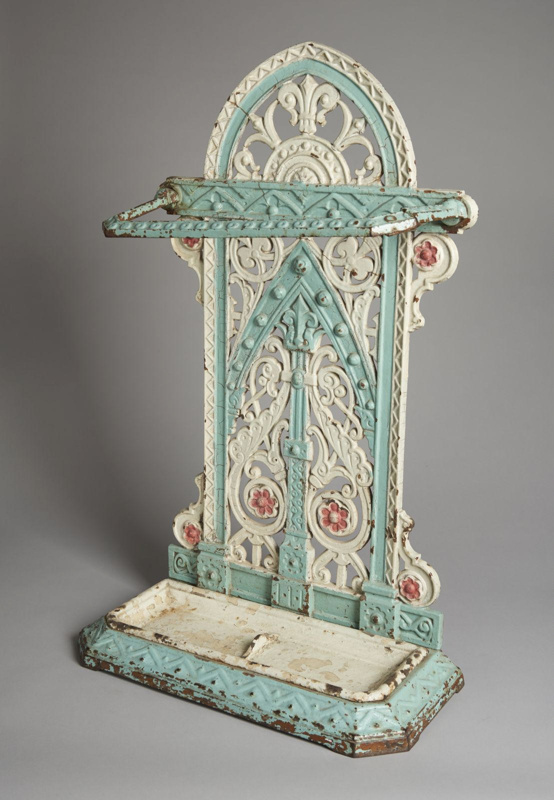 Cast iron umbrella stand painted in white, green, purple (faded).