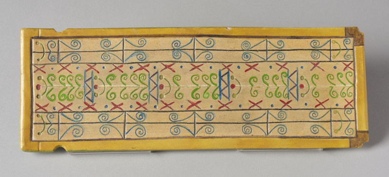 Rectangular clay plaque with colourful patterns made by Gheni York