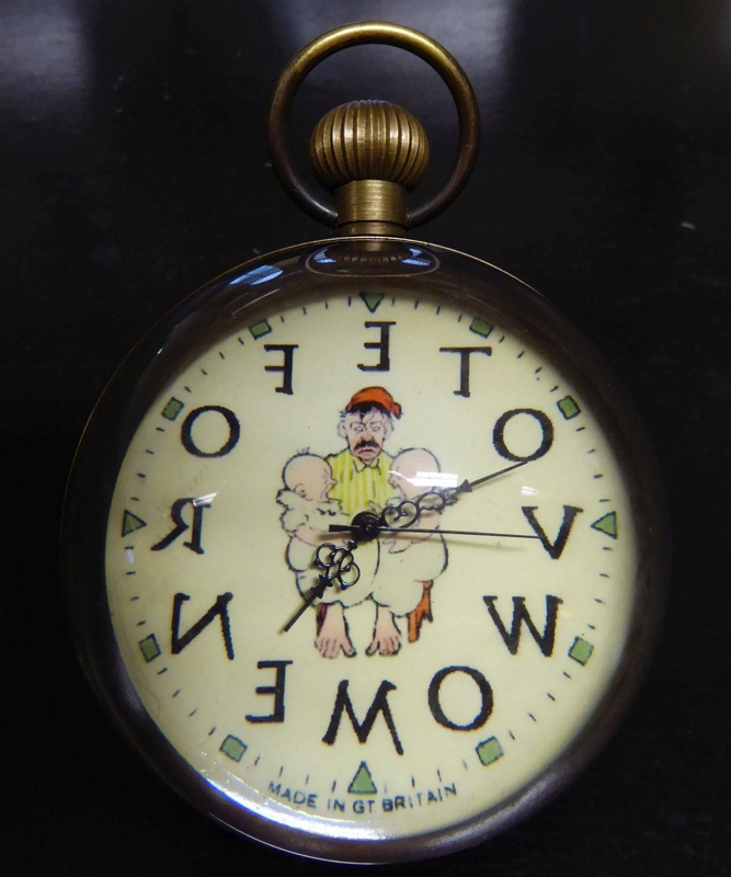 Anti-suffragette clock with depiction of a tired, angry man holding two babies on his knees