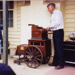Dolph Slykhuis plays his barrel organ; Jones, Alan G. (1919-2009); 2004?; P4870