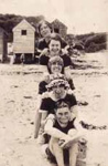 Group in bathers on beach; c. 1920; P2490