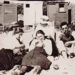 Group on beach, Beaumaris; c. 1925; P1666
